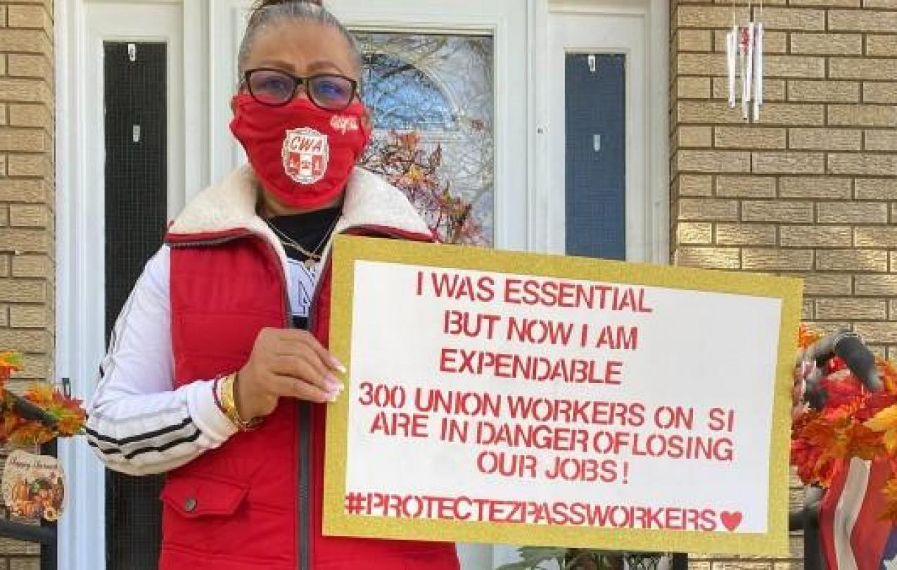 CWA Local 1102 member holding Essential Worker sign