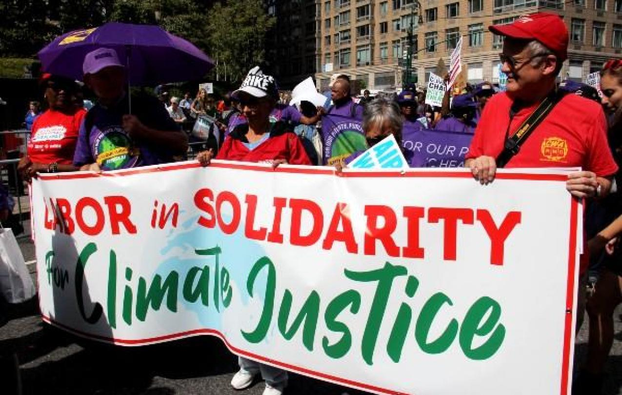 CWA members and other union members holding a Labor and Climate Justice banner
