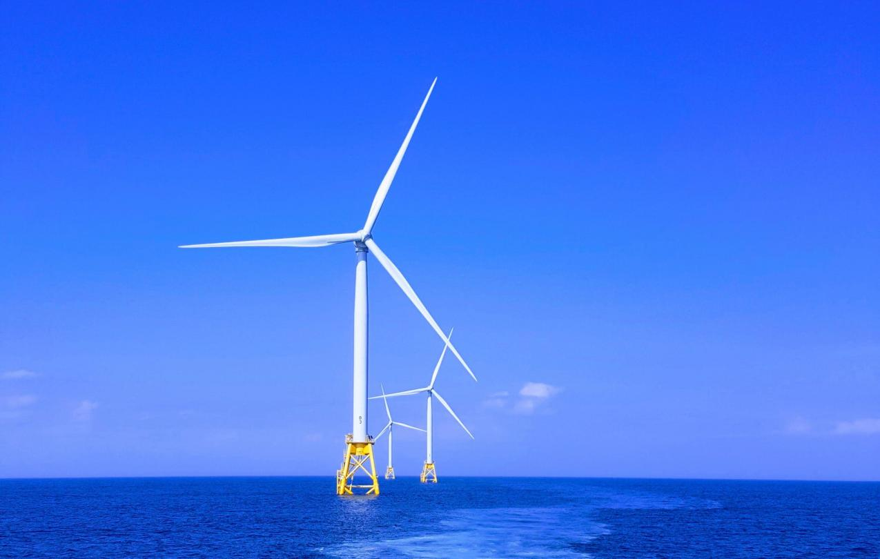 Photo by Shaun Dakin on Unsplash - offshore wind turbine