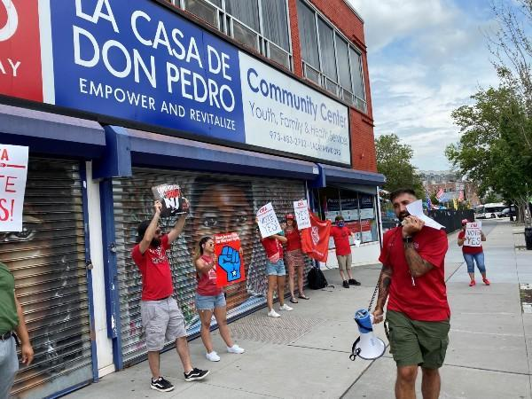 Workers rally outside of the La Casa De Don Pedro Youth and Family Services Division