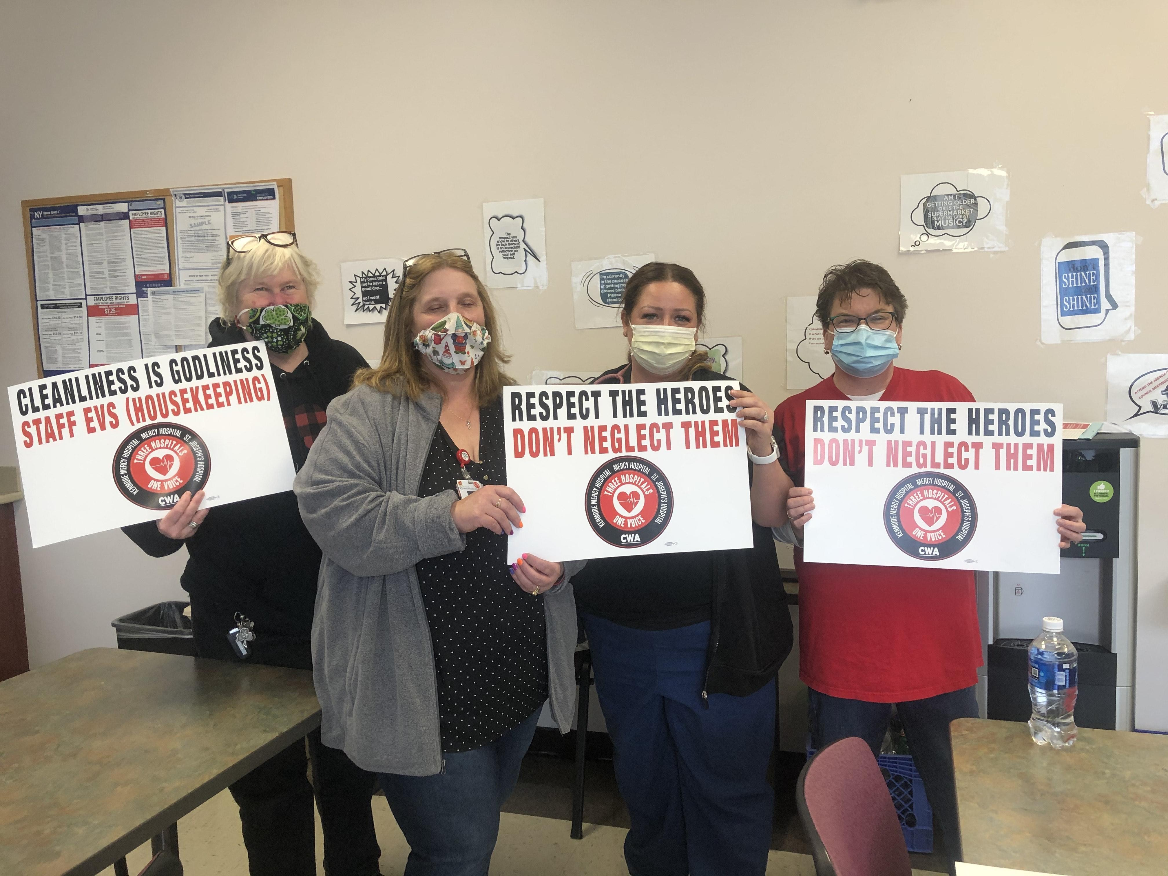 """CWA members holding signs saying """"respect the heroes"""""""