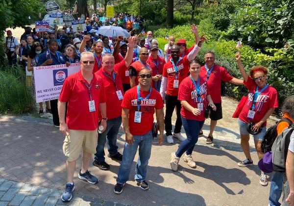Group picture of CWA members preparing to march in the Essential Workers Ticker Tape Parade