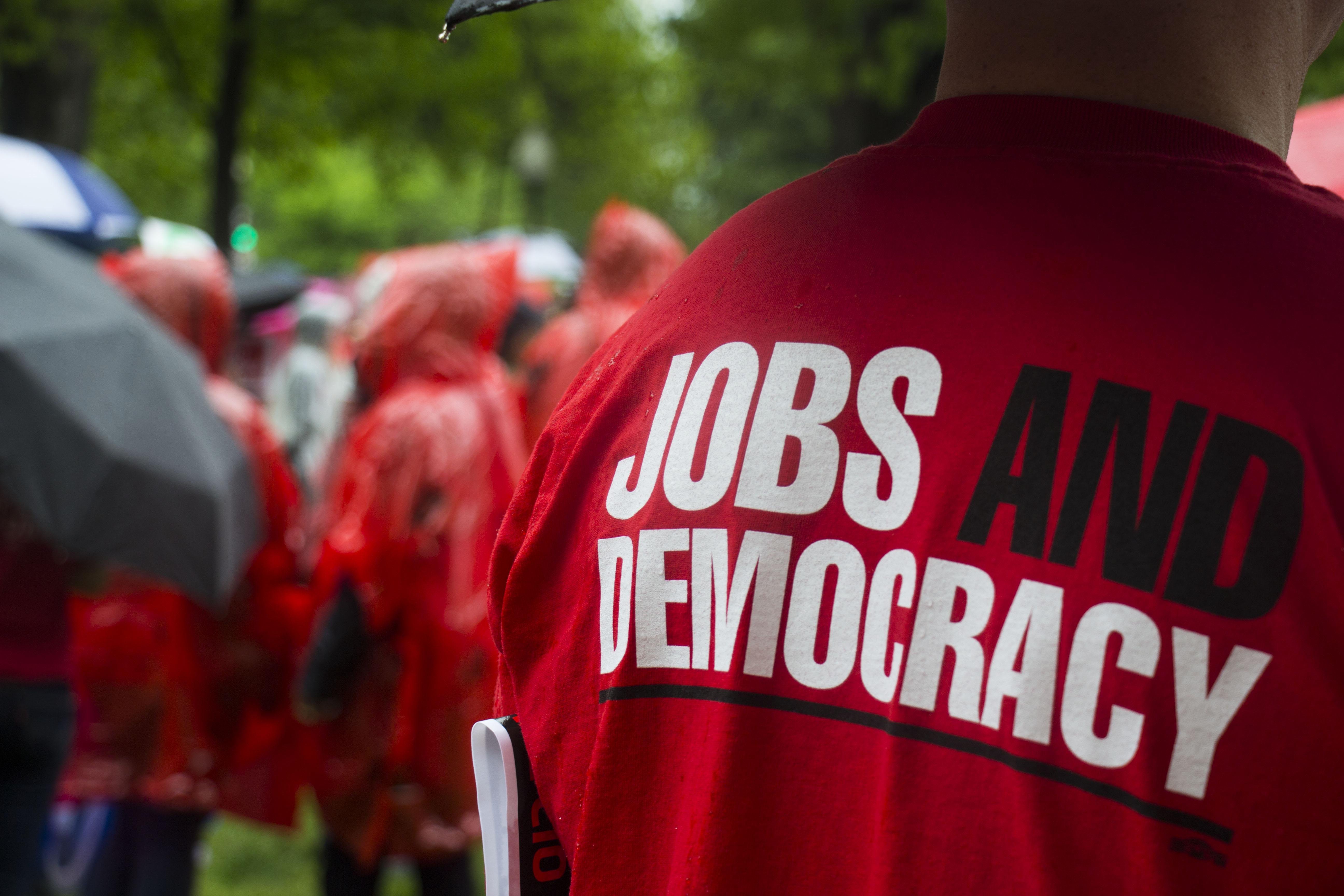 """Person wearing a """"Jobs and Democracy"""" t-shirt"""
