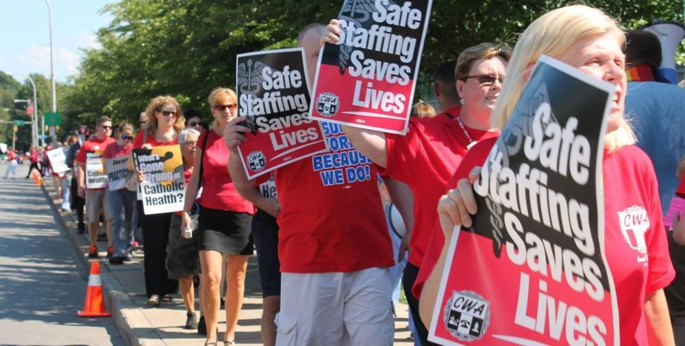 Safe Staffing rally with CWA members holding signs saying Safe STaffing Saves Lives